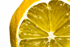 Sliced lemon on white royalty free stock images