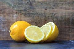 Sliced lemon on wood Stock Photography