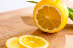 Sliced lemon on wooden board Stock Photography
