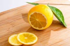 Sliced lemon on wooden board Royalty Free Stock Images