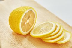 Lemon is on the cutting board. Royalty Free Stock Image