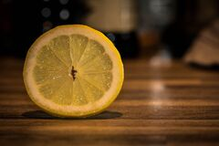 Sliced Lemonade on Brown Wooden Surface Royalty Free Stock Photos
