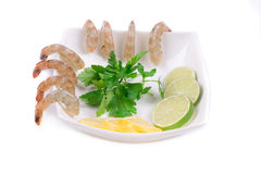 Sliced lemons and boiled shrimps. Royalty Free Stock Photography