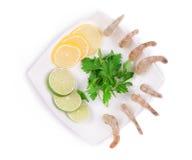 Sliced lemons and boiled shrimps. Stock Images
