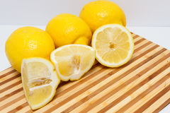 Sliced lemons on cutting board Royalty Free Stock Image