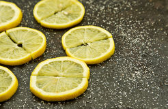 Sliced lemons with sprinkled sugar on grey Royalty Free Stock Photography