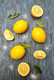 Sliced lemons on wooden background. Stock Images