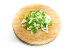 Sliced  lettuce Coriander on wooden board on white Royalty Free Stock Photos