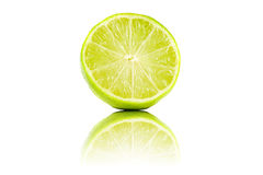 Sliced lime fruit with reflection isolated Royalty Free Stock Photos