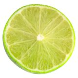 Sliced lime iisolated on white background with clipping path. Isolated fruits. Sliced lime iisolated on white background with clipping path as package design Royalty Free Stock Photography