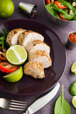Sliced lime pork tenderloin on dark canvas background close up Stock Photos