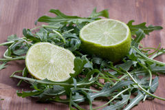 Sliced lime and rukola Stock Images