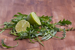 Sliced lime and rukola Royalty Free Stock Photo