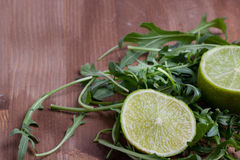 Sliced lime and rukola Royalty Free Stock Photography