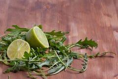 Sliced lime and rukola Stock Photos