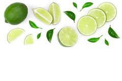 Sliced lime vith leaves isolated on white background with copy space for your text. Top view. Flat lay pattern royalty free stock photography