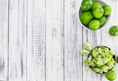 Sliced Limes & x28;selective focus, close-up shot& x29; on abright wooden table Stock Photo