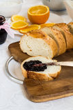 Sliced loaf of bread with currant jam with jar Stock Image