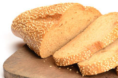 Sliced loaf of bread on a cutting board Royalty Free Stock Photography