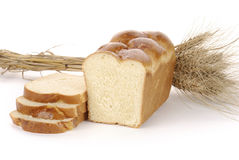 Sliced loaf of bread with spikelets Royalty Free Stock Photo