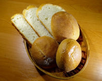Sliced loaf and and round slider buns in wicker breadbasket Stock Photo