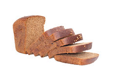 Sliced loaf of rye bread. Is isolated on a white background Stock Photos
