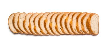 Sliced loaf of wheat bread on white background stock photo