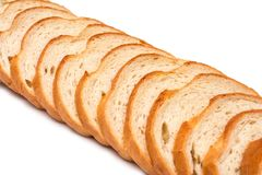 Sliced loaf of wheat bread on white background royalty free stock images