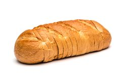 Sliced loaf of wheat bread on white background stock photography