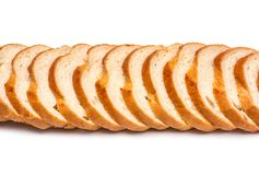 Sliced loaf of wheat bread on white background royalty free stock photography