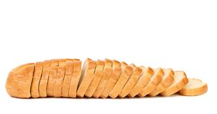 Sliced long loaf. Royalty Free Stock Photo