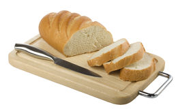 Sliced long loaf and a knife on a cutting board Royalty Free Stock Image