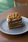 Sliced macadamia cake. Tasty cake for coffee break Royalty Free Stock Images