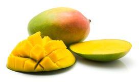 Fresh mango isolated. Sliced mango hedgehog shape isolated on white background one whole and two halves Royalty Free Stock Image