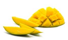 Fresh mango isolated. Sliced mango isolated on white background three slices and sliced hedgehog half Royalty Free Stock Image