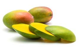 Fresh mango isolated. Sliced mango isolated on white background two whole and three slices Stock Images