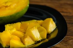 Sliced mango in plate royalty free stock images