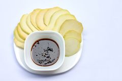 Sliced Mangoes with sweet fish sauce. royalty free stock photography