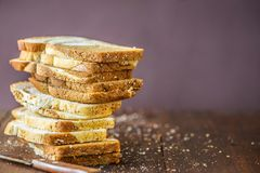 Sliced of marble bread on rustic wooden table. With copy space stock photo