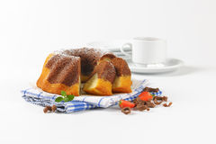 Sliced marble bundt cake and coffee Royalty Free Stock Photography