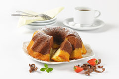 Sliced marble bundt cake and coffee Royalty Free Stock Photo