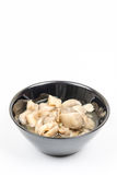 Sliced marinated mushrooms in the bowl isolated over white background Royalty Free Stock Photography