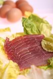 Sliced meat. Delicious fresh sliced meat on salad Stock Images