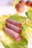 Sliced meat. Delicious fresh sliced meat on salad Royalty Free Stock Photography