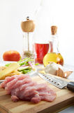 Sliced Meat. On chopping board with ingredient in background Royalty Free Stock Images
