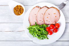 Sliced meat with arugula salad, cherry tomatoes, top view, close Stock Image