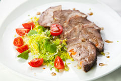 Sliced meat with fresh vegetables. Close-up photo Stock Photo