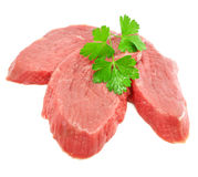 Sliced meat with leaf of green parsley Stock Photo