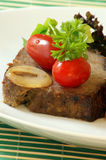 Sliced meat loaf with parsley on a plate Stock Photos