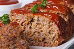 Sliced meat loaf with tomato sauce  macro, horizontal Stock Photography